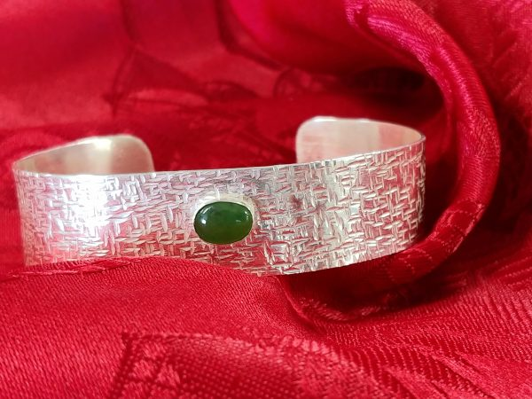 Hammered silver cuff set with a jade cabochon
