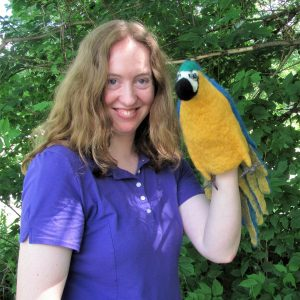 Girl with parrot puppet