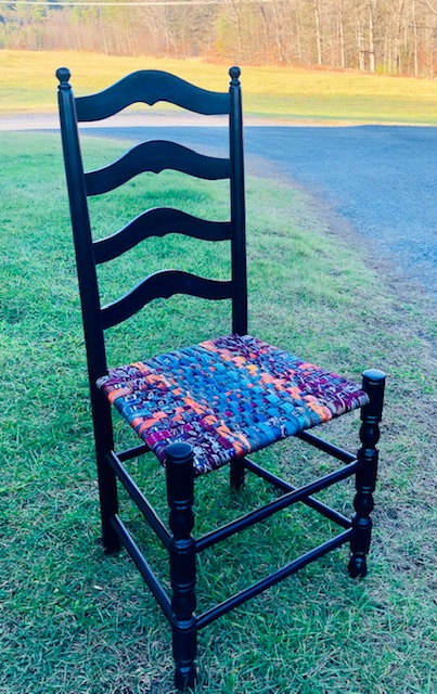 Ladder back chair with woven tie seatt