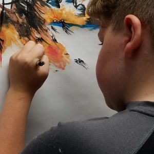 Child working on a painting