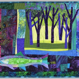 Abstract quilt depicting a forest scene and a fish