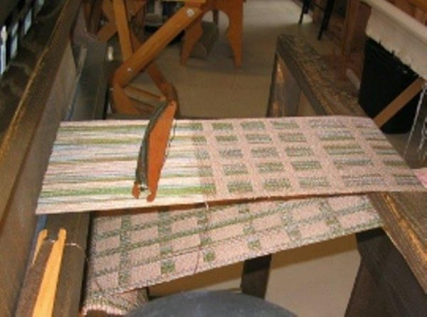 Photo of a loom with a work in progress
