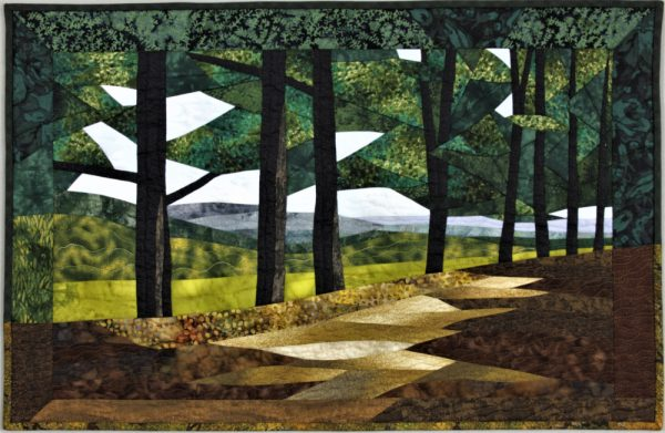 Quilt depicting a dirt lane bordered by trees.