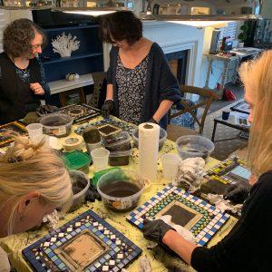 Students creating mosaic mirrors