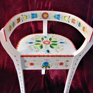 A white chair decorated with painted flowers