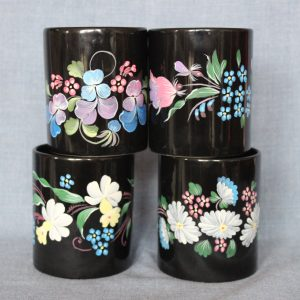 Black mugs with colorful floral painting
