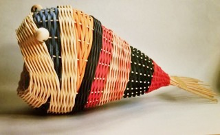 Photo of a multi-colored basket in the shape of a fish