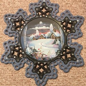 Detailed painting of a winter scene on a snowflake shape