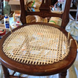 A caned seat in progress