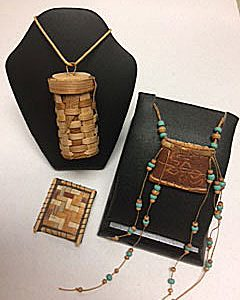 Photo of different types of woven birch bark jewelry