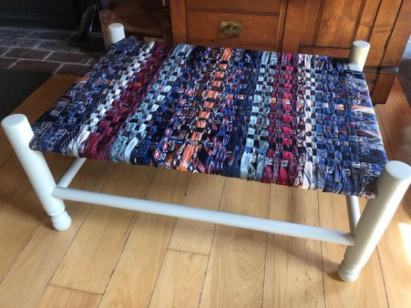 Bench with woven necktie seat