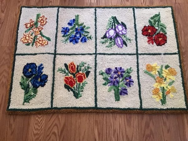 Hand-hooked rug, flowers on a cream background